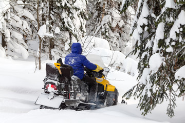 Woman on a snowmobile