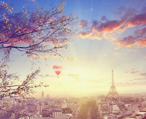 Aerial view of Paris cityscape with Eiffel tower at sunset with red balloon in form of heart Vintage colored picture Love and travel concept