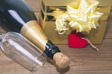 boxes gift tag with heart and glasses of champagne