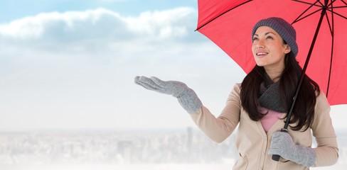 Composite image of smiling brunette feeling the rain