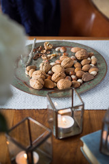 Assorted  nuts on vintage metal plate and vintage nutcracker. Selective focus.