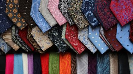 Different neckties scarfs on display
