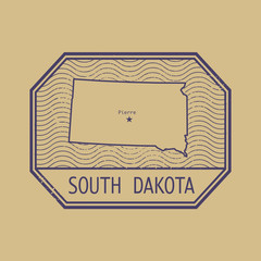 Stamp with the name and map of South Dakota, United States