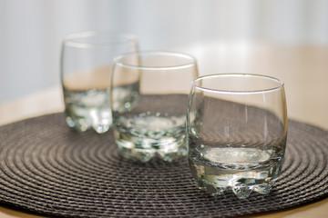 Three empty juice glasses on the table