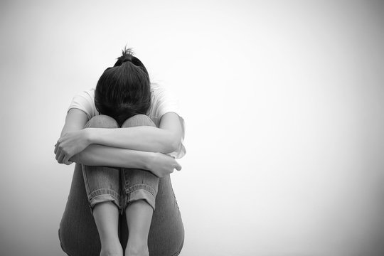 sad woman hug her knee and cry (monochrome)