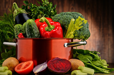 Composition with pot and raw vegetables - fototapety na wymiar