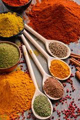 Variety of spices on kitchen table - fototapety na wymiar