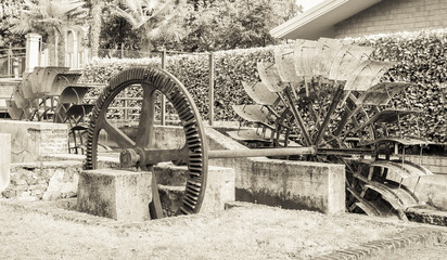 Old iron wheel a watermill. Ruins of a watermill. Effect vintage.