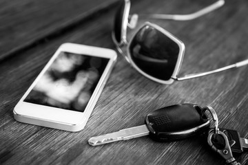 car key with smartphone and sunglasses