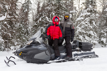 Man and woman on a snowmobile.