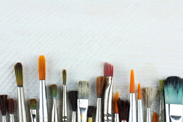 brushes for painting on wooden table closeup