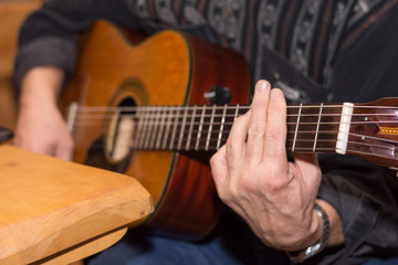 Guitarist playing accoustic guitar