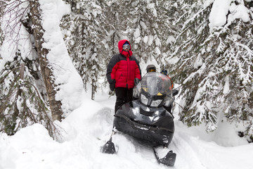 Athletes on a snowmobile