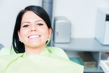Young woman patient smiling cute at dentist