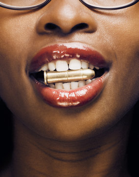 Woman with a bullet between his teeth