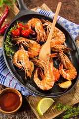 Wall Mural - Fried king prawns on iron pan
