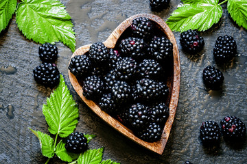 Blackberries in bowl in the shape of a heart, a top view