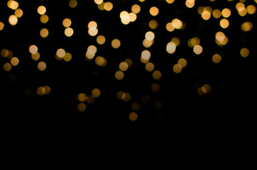 abstract golden yellow colorful circle blur bokeh lights for Christmas festival background. defocused picture