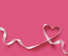 Happy Valentines Day. White Ribbon Heart on pink background. Valentines Day concept
