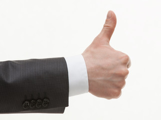Businesman's hand showing thumd up sign