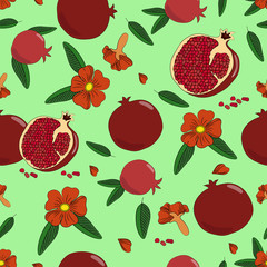Seamless pattern. Juicy pomegranate with leaves and flowers.