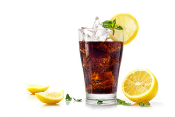 Fototapeta glass of cola or coke with ice cubes, slices of lemon and pepper