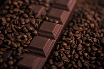 Roasted coffee beans and chocolate bar  close-up