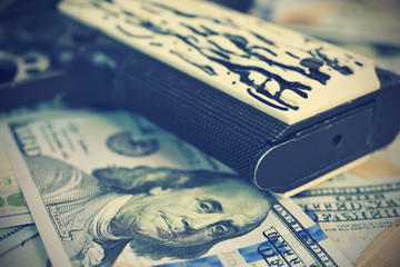 Gun grip and dollar bills
