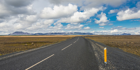 Isolated road and Icelandic colorful landscape at Iceland, summe