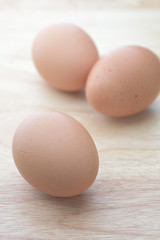 egg on brown wooden background