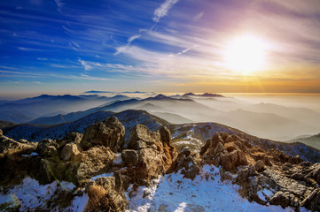 Wall Mural - Winter landscape with sunset and foggy in Deogyusan mountains, South Korea.