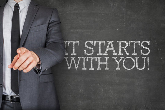 It starts with you son blackboard with businessman
