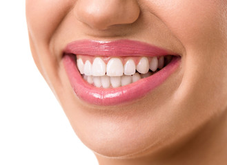 young attractive woman face with a clean white teeth