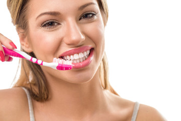 Smiling woman during brushing teeth