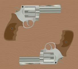 pistol handgun gun isolated revolver with wood background