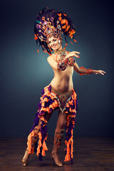 Photo Blinds Carnaval Beautiful slender dancer , belly dance in motion in a colorful costume .Dancer in motion in carnival costume
