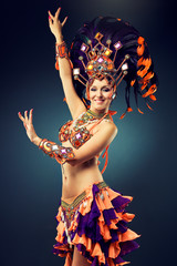Poster Carnaval Beautiful slender dancer , belly dance in motion in a colorful costume .Dancer in motion in carnival costume