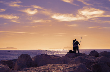 Couple in love, shooting a selfie ,on the shore of the sea, in  Naples