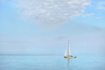 White sail yacht sailing in a calm sea. Riga, Latvia