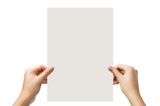 Hands holding a white paper blank isolated on white background