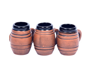 Decorative beer mugs separated on white backboard