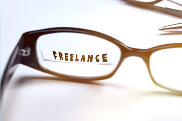Freelance wording through glasses.