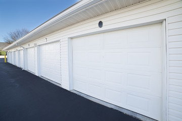 Row of garage doors at parking area for apartment homes