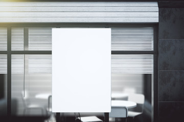 Blank white poster on transparent wall in modern conference offi