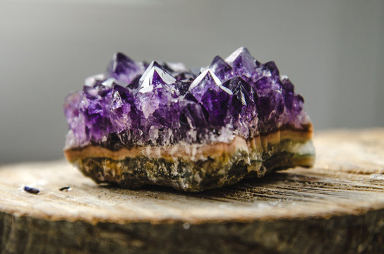 Raw amethyst rock with reflection on natural wood crystal  ametist