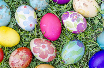 Hand painted decoupage Easter eggs on the grass