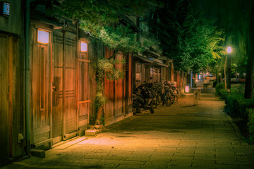kyoto street at night with restaurants and bars