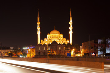 The New Mosque in Istanbul, Turkey at night with city traffic