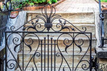 Antique iron gate in the rain.