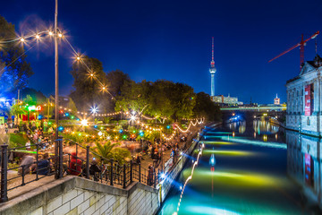 Berlin Strandbar party at Spree river with TV tower at night, Germany